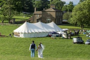 9x21m-petal-pole-marquee-In-Field-Yorkshire-Yurts